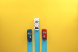 Three cars isolated on the yellow background.  Business and management concept