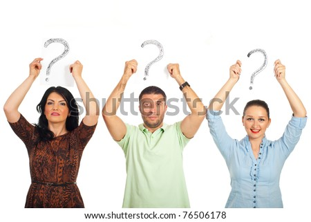 Three casual people standing in a line and holding questions marks  over their heads isolated on white background