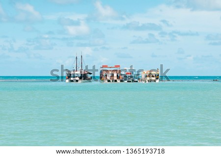 Three Catamaran boats in the middle of sea. Touristic Catamarans taking tourists to swim in Picaozinho corals, at Joao Pessoa PB Brazil. #1365193718