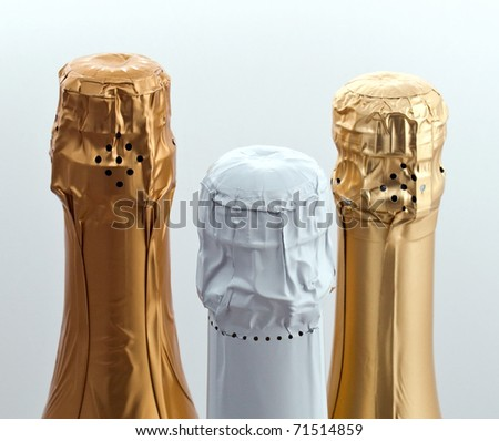 Three champagne different bottle tops