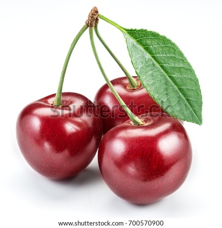 Three cherries with cherry leaf isolated on a white background.