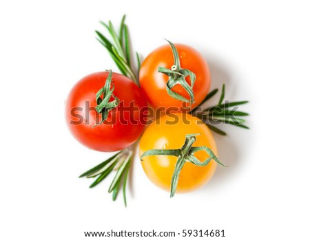 three cherry tomatoes with rosemary from above on white