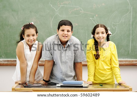Three children in classroom