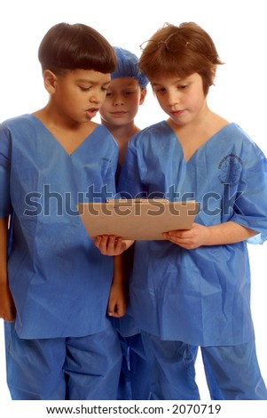 Three children in scrubs studying data on a clipboard.  Vertical, isolated on white.