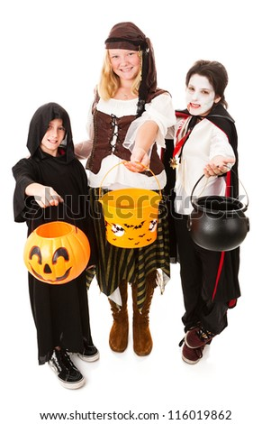 Three children of various ages dressed for Halloween.  Full body isolated on white.