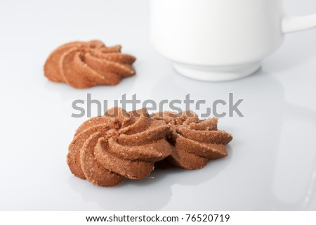 three chocolate biscuits with milk