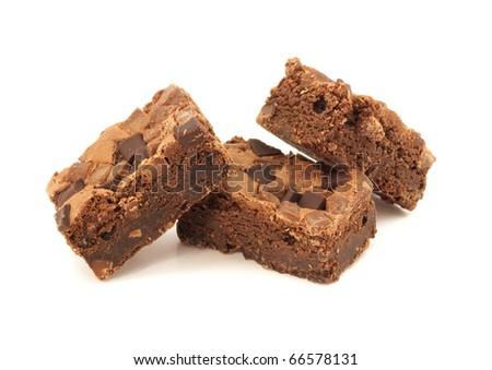 Three chocolate brownies on white