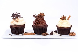Three Chocolate sweet cupcakes on a white background