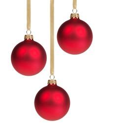 three christmas balls hanging on ribbon isolated on white