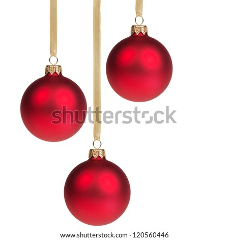 three christmas balls hanging on ribbon isolated on white
