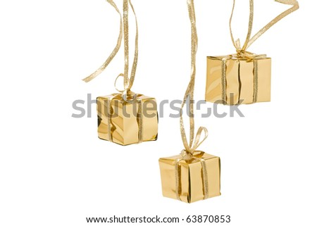 Three christmas presents wrapped in gold packing paper