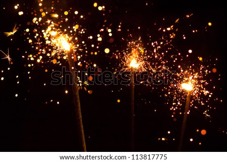 three christmas sparklers