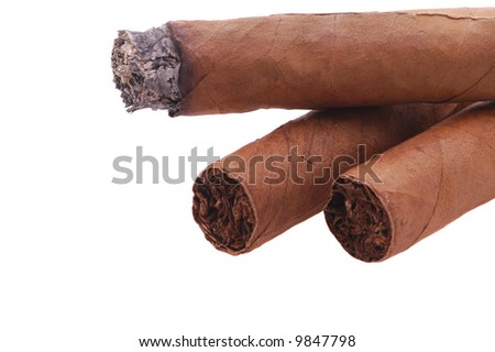 Three Cigars 0ne Lit isolated over white