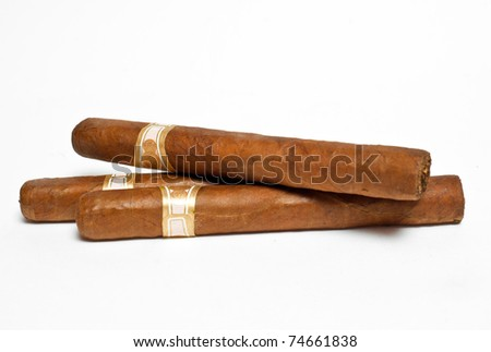 three cigars on white background