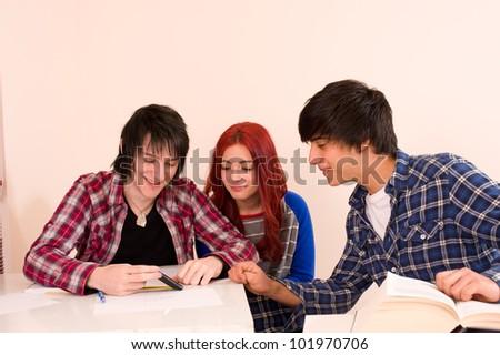 Three classmates using a smartphone