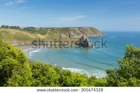 Three Cliffs Bay south coast the Gower Peninsula Swansea Wales uk in summer with blue sea and sky