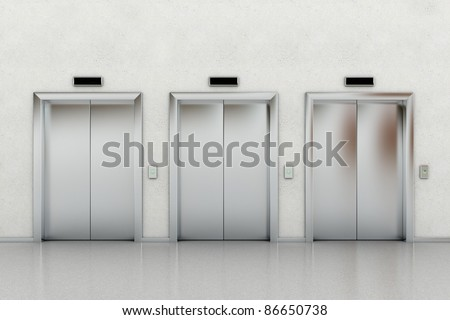 Three closed elevators in a business lobby