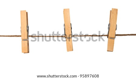 three clothespins on rope