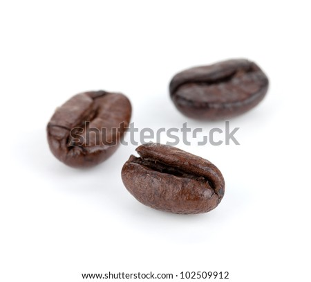 Three coffee beans. Small DOF. Isolated on white background
