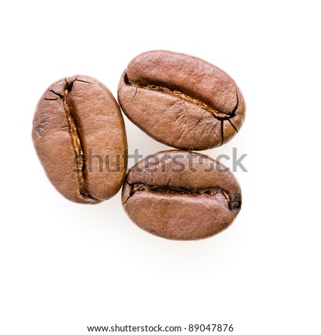 Three coffee beans with shadow isolated on white background.