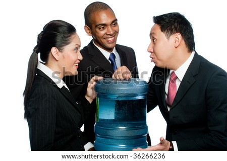 Three colleagues stand around a water cooler gossiping
