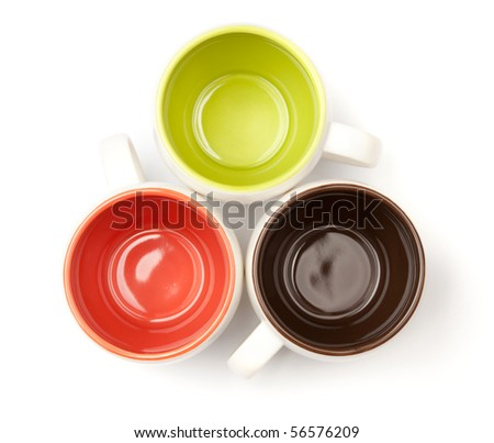 Three color coffee cups, above view, isolated on white background