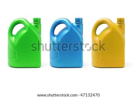 Three color containers of lubricant on white background