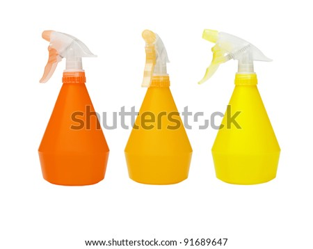 Three Color Plastic Spray Bottles on White Background