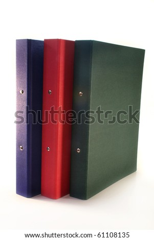 three colored folders on a white background