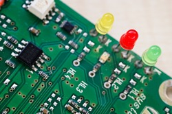 Three colored LEDs on a printed circuit board.