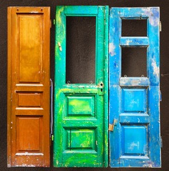 Three colored old wooden doors background