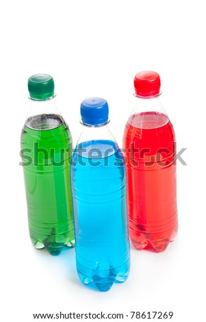 three colored plastic bottle with juice