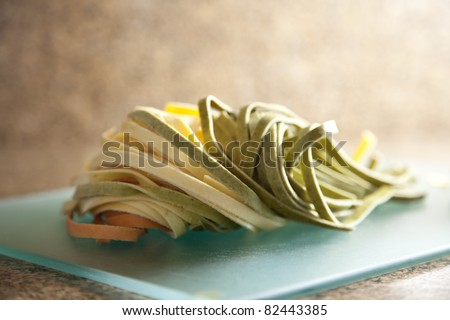 Three colored raw and fresh pasta.