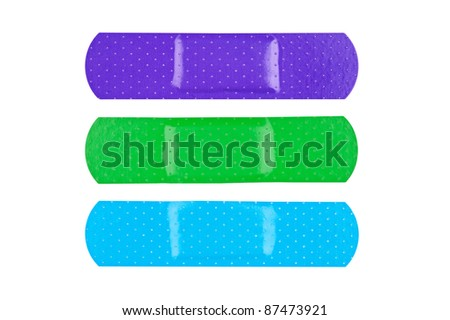 Three colorful adhesive bandages isolated on white