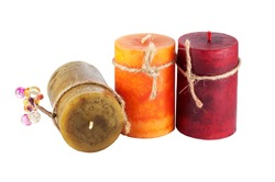 three colorful candles  isolated on white background