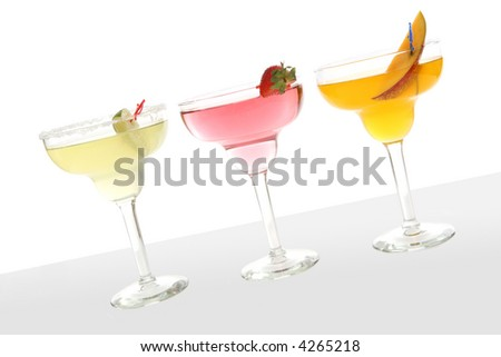 Three colorful cocktails over a white background
