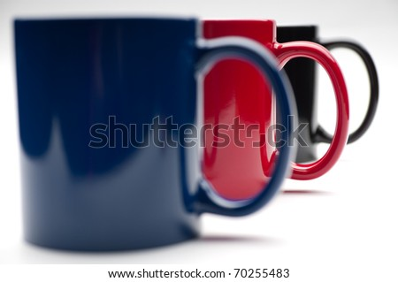 three colorful cups on a white background