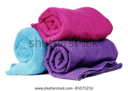 Three colorful fleece blankets