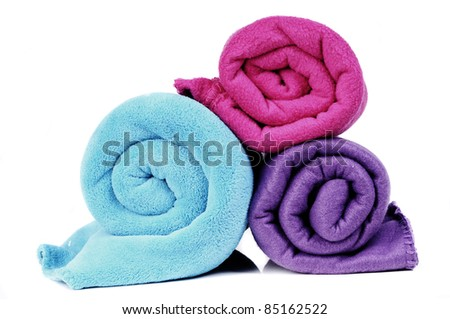 Three colorful fleece blankets