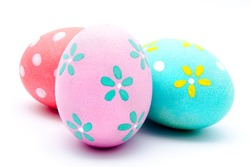 Three colorful handmade easter eggs isolated on a white