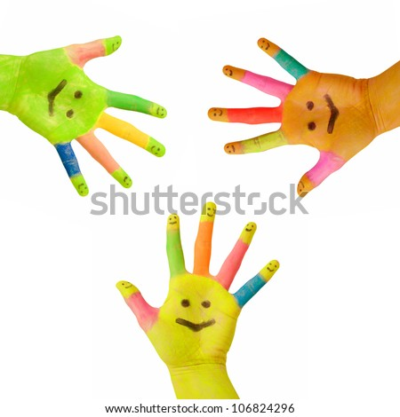 Three colorful hands  with smile painted on palm and happy finger smileys as logo. Concept of partnership, social network or celebration. Isolated on white background with clipping path