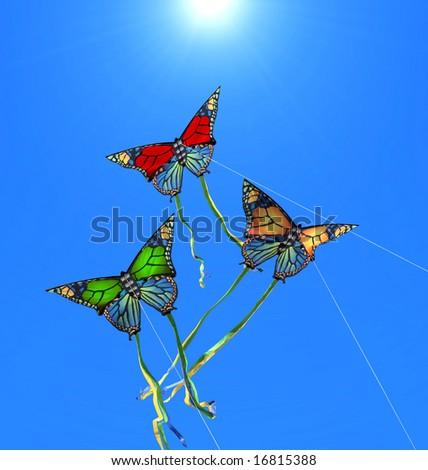 Three colorful kites at sunny sky