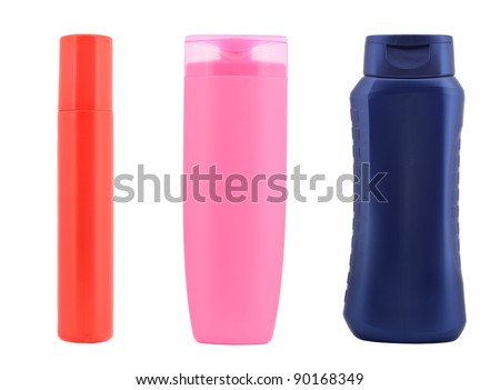 three colorful plastic bottles (could be shampoo, gel, sun tan, lotion) isolated on white background