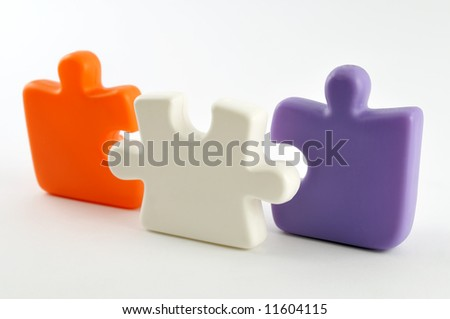 Three colorful puzzle pieces isolated on white