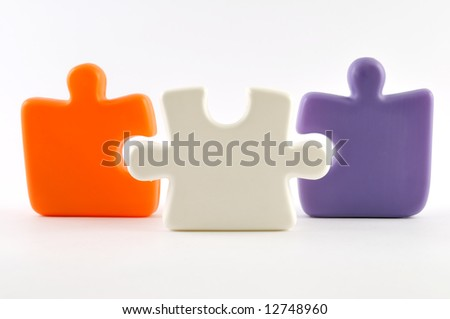 Three colorful puzzle pieces isolated on white - stock photo
