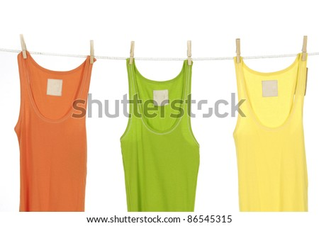 Three colorful shirt clothespins on rope