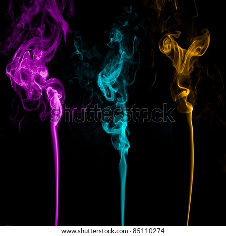 Three Colorful Smoke on black background.