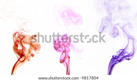 Three colorful streams of smoke isolated on a white background