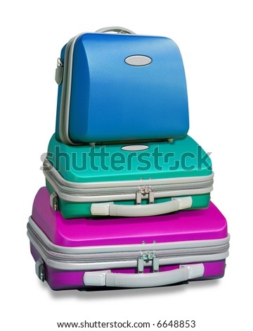 Three colorful suitcases piled on top of each other islolated on a white background with clipping path supplied