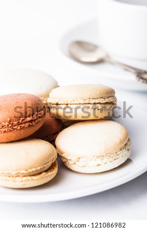 Three colors of macaroons in brown and beige tones